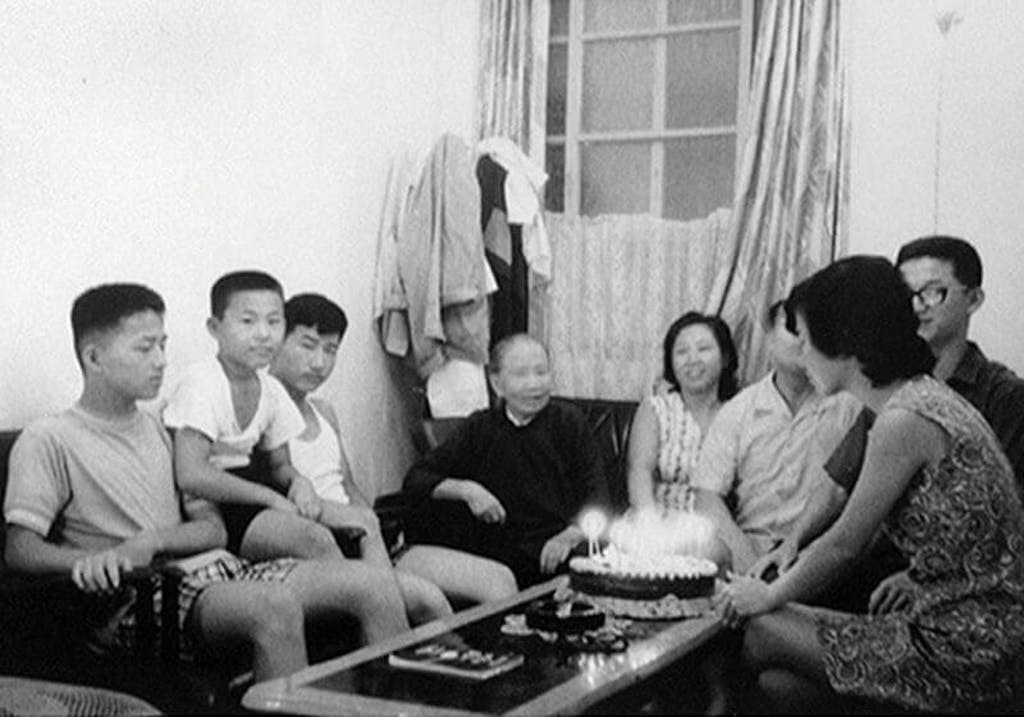 With Grandma, parents and siblings