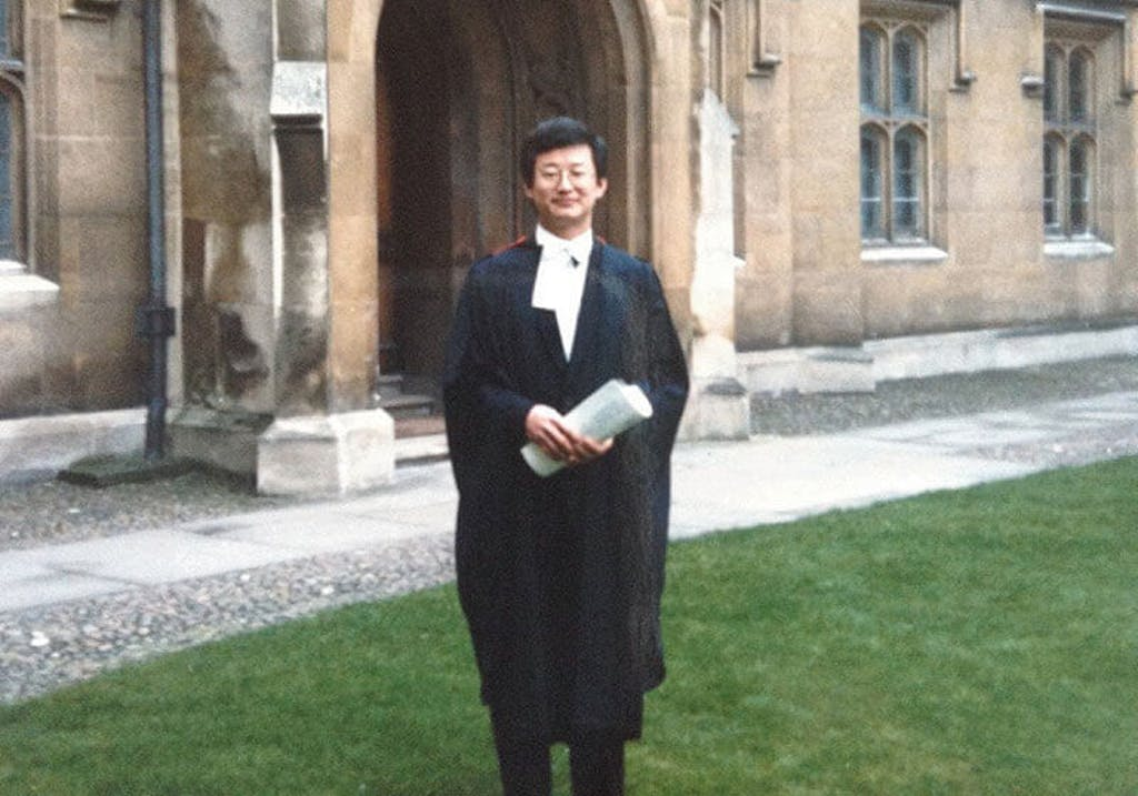 Prof. Wang in front of Sidney Sussex College at PHD graduation, Cambridge, 1987