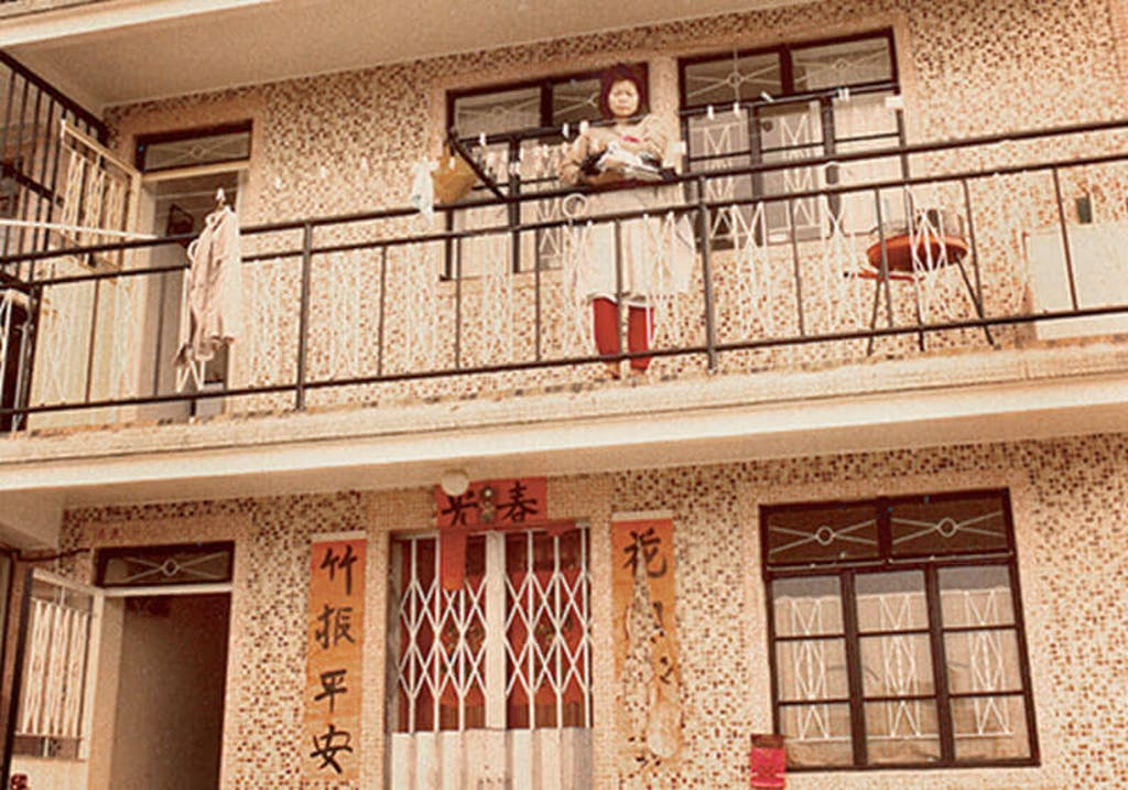 Ling on the first floor balcony outside her parent's flat, Sai Kung, Hong Kong, 1983