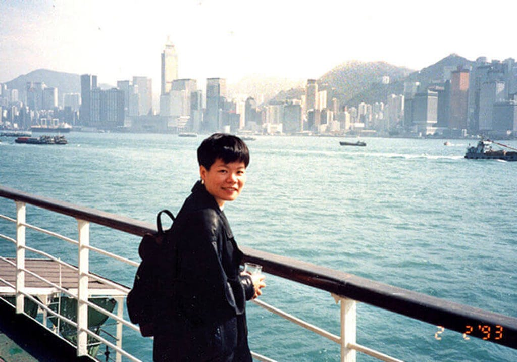 Ling set off from Hong Kong to Shanghai. The boat trip took her three days. Background is Wan Chai, Hong Kong, 1993
