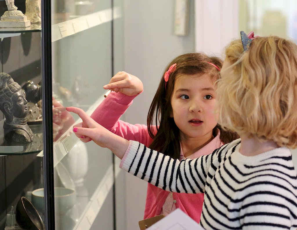 Children are looking at the objects in the display