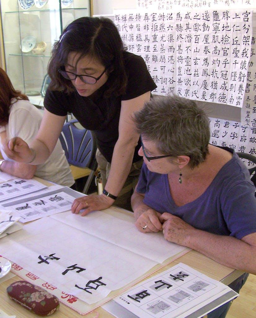 artist Ai-Li is teaching calligraphy
