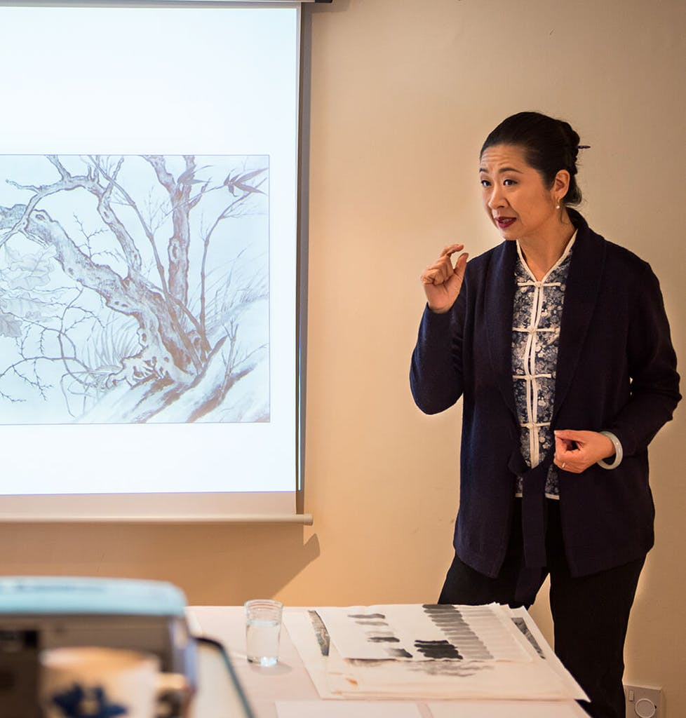 Artist Wu Lan Chian is giving a talk on Chinese ink painting